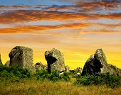 image of megaliths  - Sunset above the megalithic monuments menhirs in Carnac - JPG