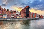 Gdansk at sunset with reflection in Motlawa river, Poland
