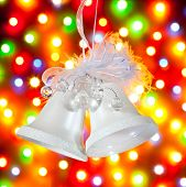 stock photo of christmas bells  - two white bells on a colored background - JPG