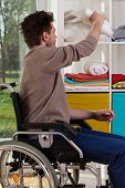 Disabled Man Reaching Out For Blanket