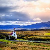Traditional Icelandic church near Helgafell Mountain in western Iceland