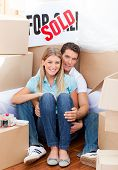Intimate Couple Embracing After Move In