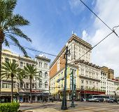 Crossing Canal Street With Bourbon Street And Famous Astor Hotel