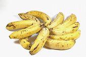 Eleven Yellow Ripe Bananas In Random Formation