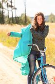 Attractive brunette girl during her cycling