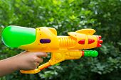 Children Water Gun In A Children's Hand