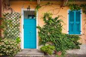 Colorful Door And Shutters. Mandello Del Lario,lake Como, Italy