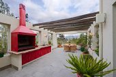 Interior design: Beautiful modern terrace lounge and BBQ