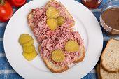 Pork Sandwich On White Plate