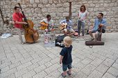 DUBROVNIK, CROATIA - MAY 27, 2014: Street musicians performing in the srteets of the old town of Dub