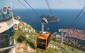 DUBROVNIK, CROATIA - MAY 26, 2014: Cablecar arriving at top of Srd mountain above Dubrovnik, Croatia