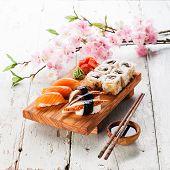 Sushi Set: Sashimi And Sushi Rolls On Blue Background