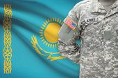 American Soldier With Flag On Background - Kazakhstan