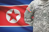American Soldier With Flag On Background - North Korea