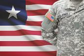 American Soldier With Flag On Background - Liberia