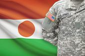American Soldier With Flag On Background - Niger