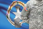 American Soldier With Flag On Background - Commonwealth Of The Northern Mariana Islands