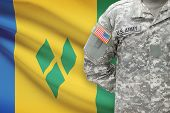 American Soldier With Flag On Background - Saint Vincent And The Grenadines