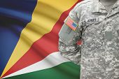 American Soldier With Flag On Background - Seychelles