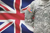 American Soldier With Flag On Background - United Kingdom