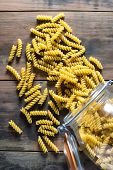 Rotini Pasta Spirals Spilled Onto A Rustic Table