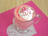 foto of doilies  - Pink cake with sprinkles in a mug on a lace heart doily - JPG