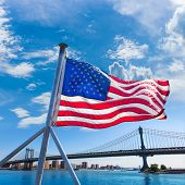 Manhattan Bridge with American flag from Brooklyn New York city US