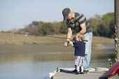picture of grandfather  - father and son or grandfather and grandson fishing - JPG