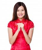 Chinese woman with hand shake for congratulation sign
