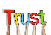Diverse Hands Holding the Word Trust