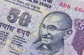 stock photo of indian currency  - Close Up Of An Indian 50 Rupee Note Featuring Mahatma Gandhi - JPG