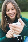 Cute brunette woman texting on her mobile