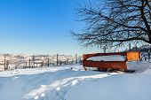 Rural cart on the field covered with snow in Piedmont, Northern Italy.