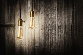 Antique light bulbs on wooden background