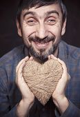 Man holding heart in his hands