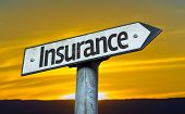 Insurance sign with a sunset background