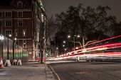 stock photo of london night  - London street in the middle of the night with light trails from vehicles passing by - JPG