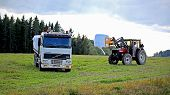 Stacking Up Silage Onto A Volvo Fh12 Flatbed Truck