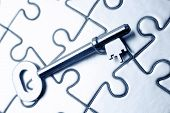 Single key resting on jigsaw puzzle