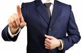 Businessman hand pushing screen, close-up
