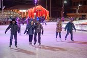 People Skating At Winter Night