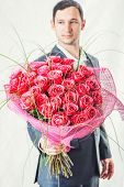 Man Holding Big Bunch Of Red Roses