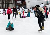 Citizens Resting On Winter Ice Rink