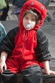 Jerusalem, Israel - March 15, 2006: Purim Carnival. Portrait Of A Young Boy Dressed Like A Ladybird.