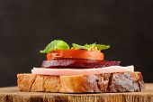 Sandwich With Ham, Beetroot And Tomato On Black Background