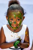 Cute African Girl At Painting Session.