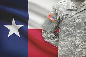 foto of texas flag  - American soldier with flag on background  - JPG