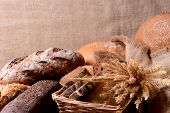 Different bread on table on sack background