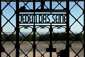 WEIMAR, GERMANY - JUNE 21, 2013: Notorious Nazi motto Jedem das Seine (To Each His Own) seen on the main gate of the Buchenwald concentration camp near Weimar, Germany.