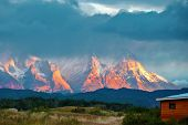 Sunrise on a windy day. Camping in the valley of the river Serrano. National Park Torres del Paine